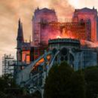 Logo of the podcast The Notre-Dame Fire Could Be a Turning Point for the Macron Presidency