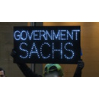 Logo of the podcast Government Sachs: Protesters Decry Financial Giant Swamping Incoming Trump Administration