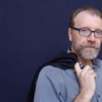"Logo of the podcast George Saunders Reads ""Elliott Spencer"""