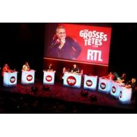 """Logo du podcast """"Les Grosses Têtes"""" sont à Lyon"""