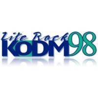 Logo of radio station KODM 97.9 FM