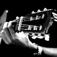 Logo de la radio Радио Каприз - Акустическая гитара